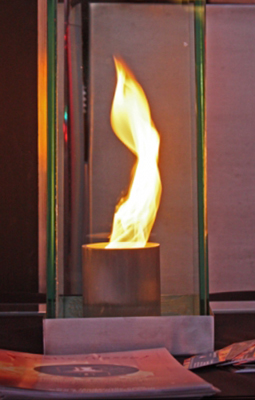 Swirling fire in glass outdoor feature